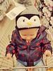 Rocking the penguin hat.