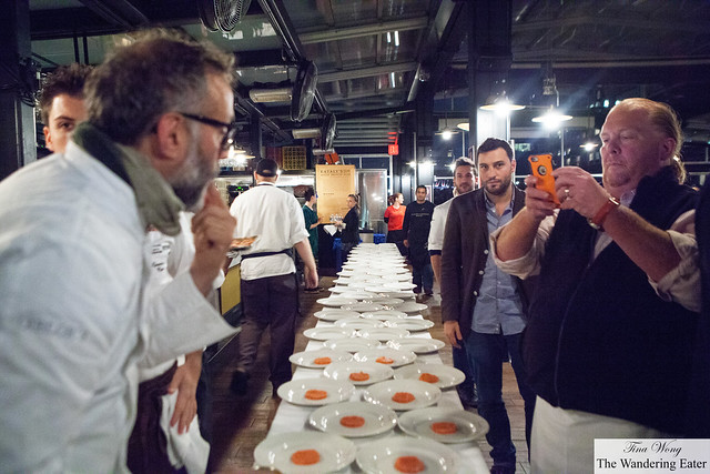 Mario taking an iPhone picture of Massimo Bottura