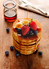 Pancakes with fruits and maple syrup