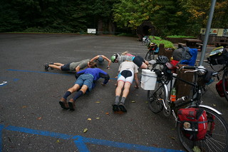 Young cyclists doing pushups