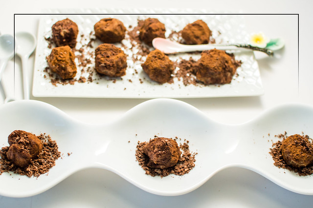rum-infused chestnut bonbons with dark chocolate-crystallized ginger dust