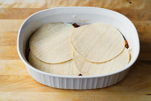 Place 4 tortillas on top in a casserole dish