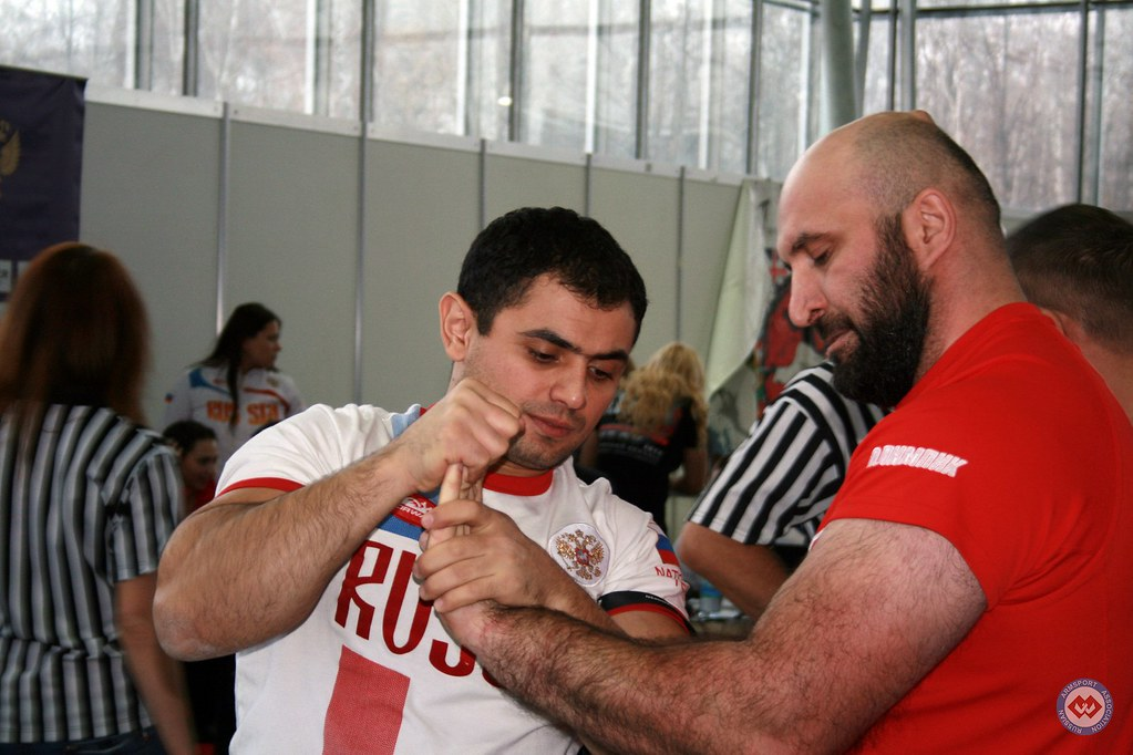 Vadim Akperov massaging Imiraslan Agashirinov's hand - Moscow Armwrestling Championship 2014 │ Photo Source: armsport-rus.ru