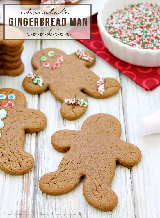 Chocolate Gingerbread Man Cookies with a bowl of red, white and green sprinkles.