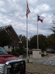 Flags flying outside the fire station
