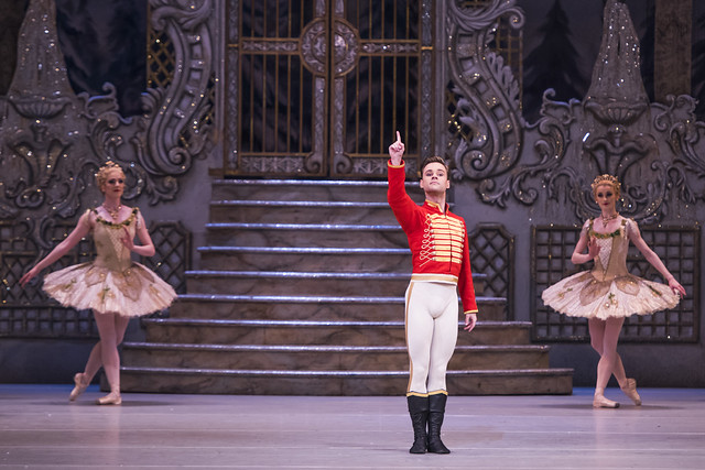 Alexander Campbell as Hans-Peter/The Nutcracker and Demelza Paris and Anna Rose O'Sullivan from the corps de ballet in The Nutcracker, The Royal Ballet © 2015 ROH. Photograph by Tristram Kenton