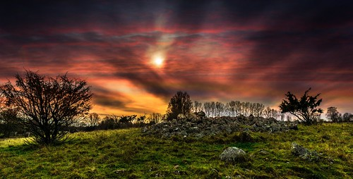 old sunset red sun green stone clouds sunrise landscape sweden stones watch dramatic graves bushes falköping