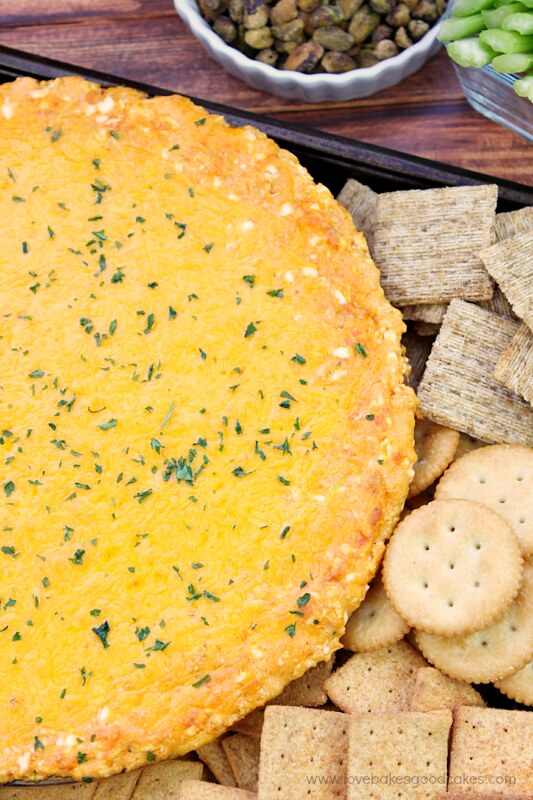 Buffalo Chicken Dip with assorted crackers.