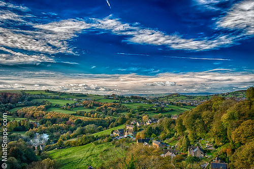 blue clouds cotswolds green hills sky stroud view houses trees