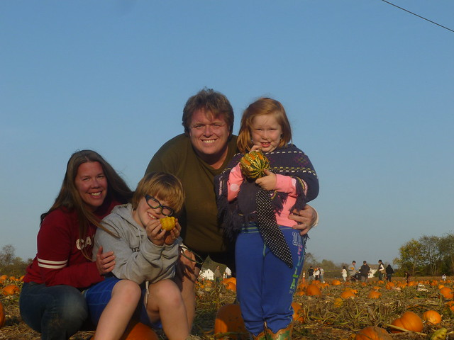 Family Portrait in the Field (with camera perched atop two stacked pumpkins)