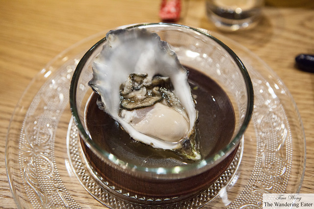 Belon oyster topped with Buddha hand broth, shiso and scallion