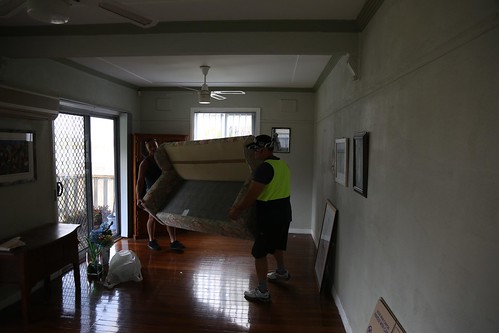 Removalists transporting lounge out of house photo | by sunset_removals