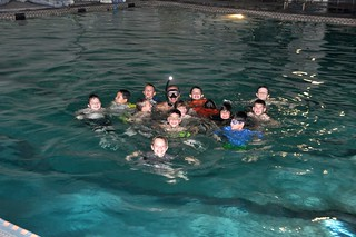 Coast Guard Petty Officer 3rd Class Nicholas McConnell, a rescue swimmer from the local Air Station, teaches Webelos from a Corpus Christi Cub Scout pack some water survival skills Tuesday, Oct. 21, 2014. The Scouts asked the Coast Guard for help with their Aquanaut badges. (U.S. Coast Guard photo)