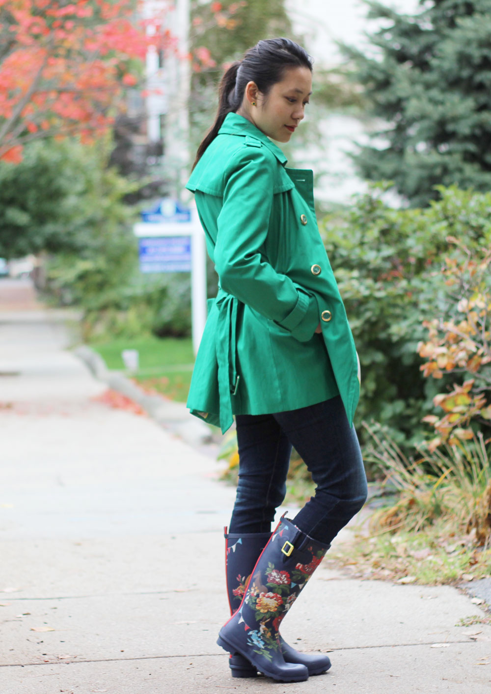 Green trench coat and Joules navy floral wellies