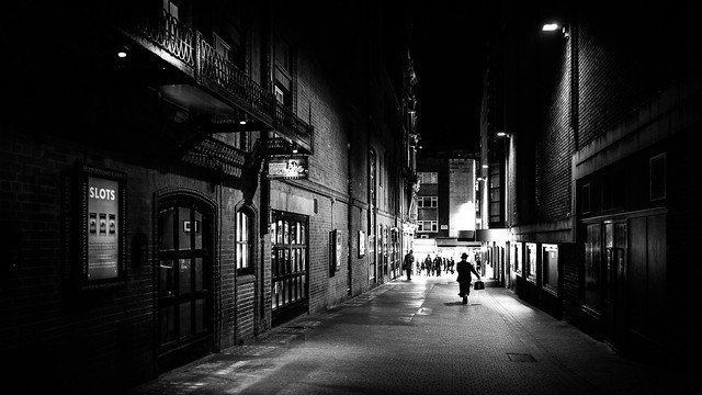 A man walking at night - London, England - Black and white street photography