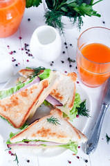 breakfast with club sandwich and juice