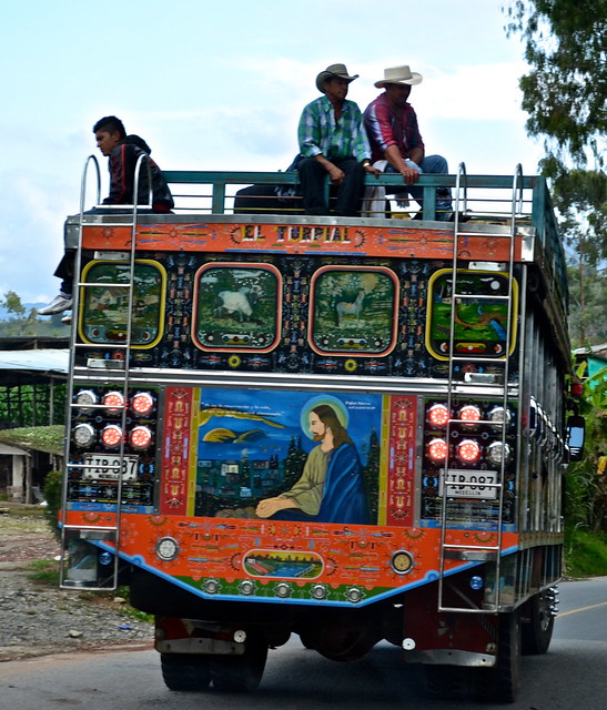 chiva on a country road, guatape colombia