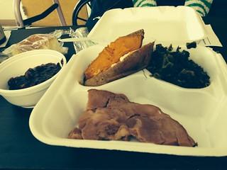 A good meal, pork chop, sweet potato, and turnip greens