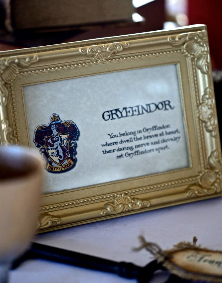 Table names with sorting hand quote  at this Scottish Harry Potter wedding on @offbeatbride
