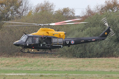 ZJ240 - 1997 build Bell 412EP Griffin HT.1, departing Barton after a training sortie