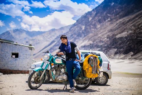 Traveler posing with Royal Enfield, Nubra Valley, Ladakh, India