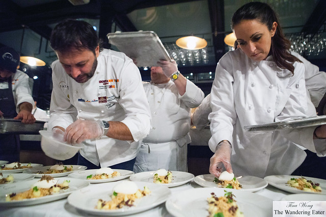 Chef Ugo Alciati (left) and another chef plating the desesrt course
