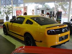 classic car(0.0), automobile(1.0), automotive exterior(1.0), boss 302 mustang(1.0), wheel(1.0), vehicle(1.0), automotive design(1.0), rim(1.0), auto show(1.0), bumper(1.0), land vehicle(1.0), muscle car(1.0), supercar(1.0), sports car(1.0),