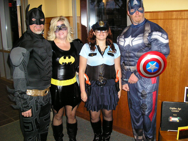 Costumed crowd Batman Batwoman Gotham Cop Capt America
