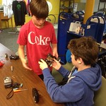 Ari and Paul from Peer Corps repairing an r/c car
