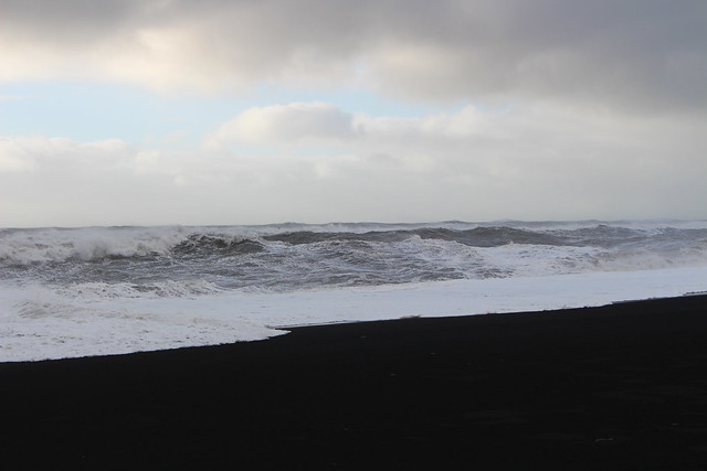 waves and black sand
