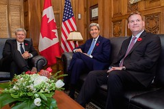 Canadian Prime Minister Stephen Harper welcomes U.S. Secretary of State John Kerry and Canadian Foreign Minister John Baird to his office on Parliament Hill in Ottawa, Canada, on October 28, 2014, as the Secretary visited to pay condolences following last week's attacks and for a series of bilateral meetings. [State Department photo/ Public Domain]