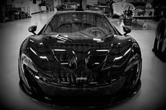 wheel(0.0), automobile(1.0), vehicle(1.0), performance car(1.0), automotive design(1.0), auto show(1.0), mclaren automotive(1.0), land vehicle(1.0), monochrome(1.0), luxury vehicle(1.0), black-and-white(1.0), black(1.0), supercar(1.0), sports car(1.0),