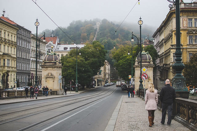 A foggy view up a fall hill in Prague.