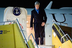 U.S. Secretary of State John Kerry steps off his airplane after arriving in Vienna, Austria, on November 20, 2014, to join negotiations with Iranian officials about the future of their nuclear program. [State Department photo/ Public Domain]