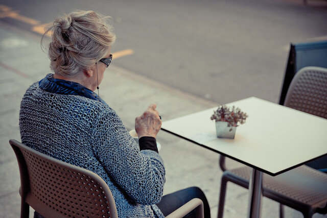 Lonely old woman having a coffe [Explored]