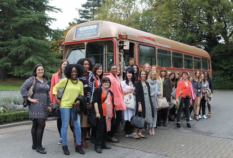 Group shot in front of bus