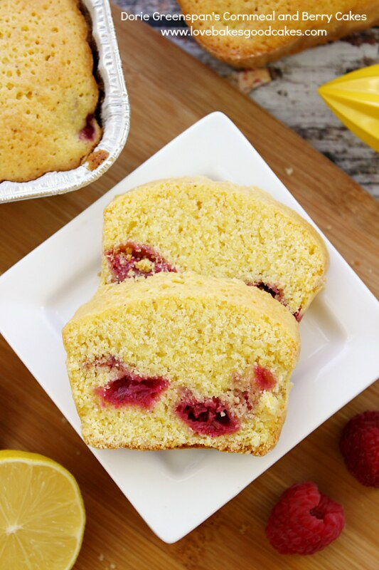 Cornmeal and Berry Cakes on a white plate.