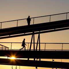 Rising sun on a bridge