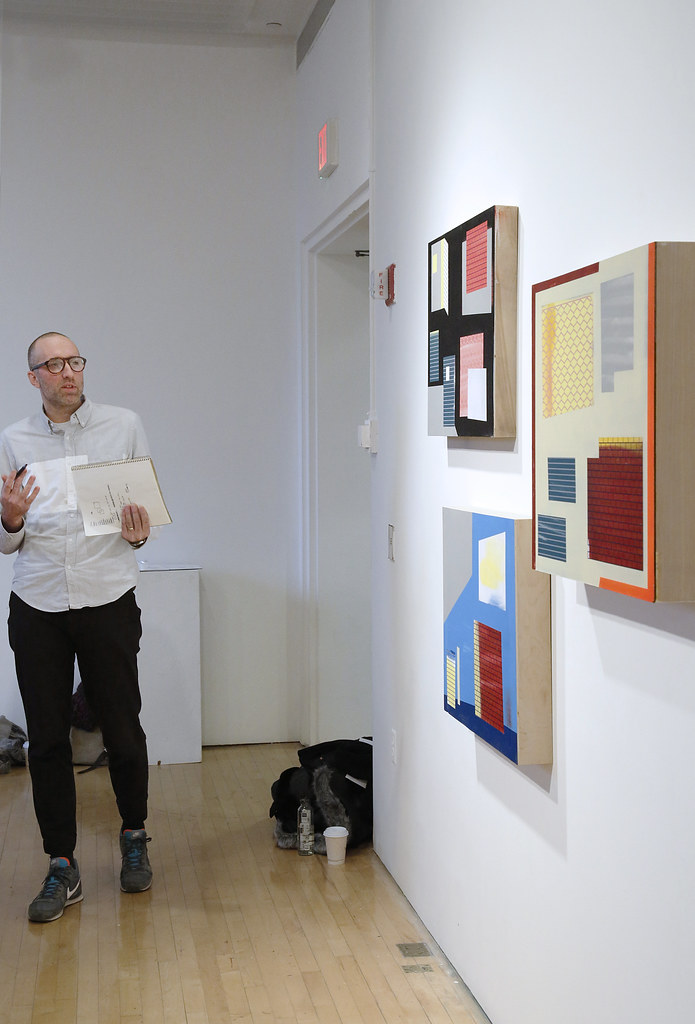Kaleb Hunkele (M.F.A. '18) presents his paintings during the M.F.A. all-faculty critique.
