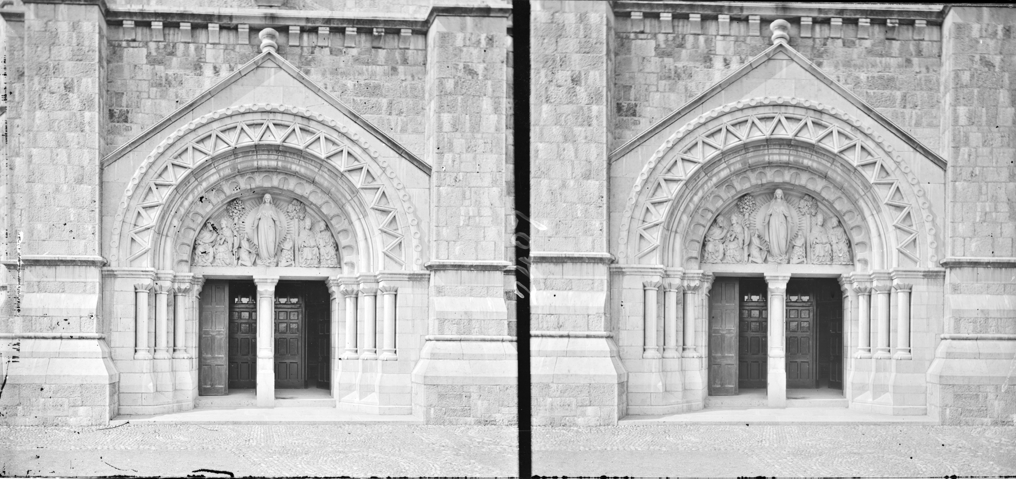Close-up of doorway of large, cruciform, modern romanesque church (is Sligo Cathedral)