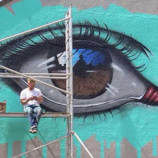 I'm not sure who took this picture of me working on my wall for Upfest this year but I do love it.