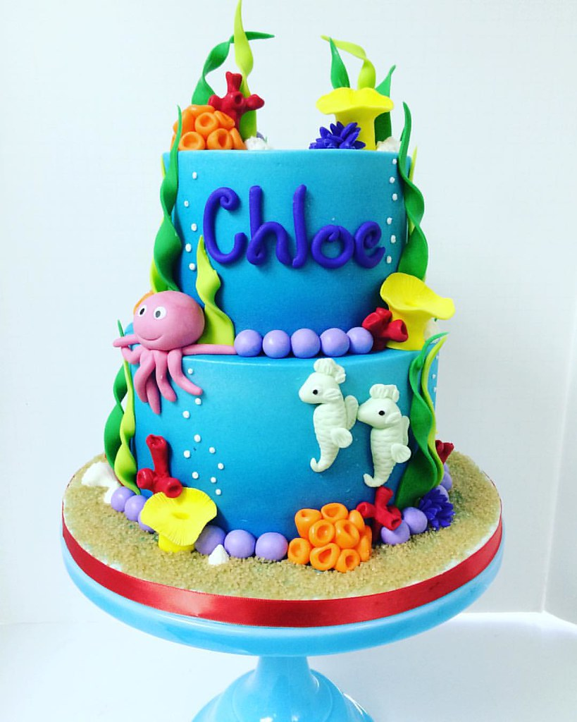 Bright and colorful under the sea themed birthday cake with mint