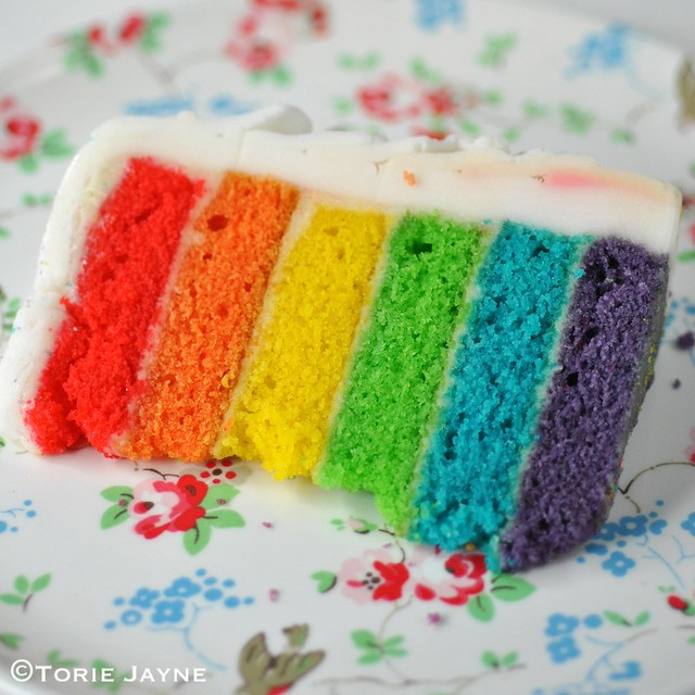A slice of rainbow cake
