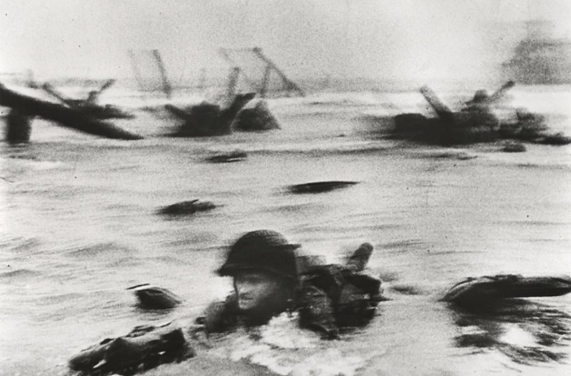 American soldiers landing on Omaha Beach during D-Day, by Robert Capa