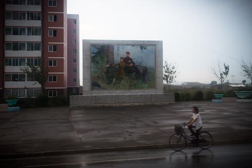 dprk northkorea korea mural billboard military rain city urban sariwon