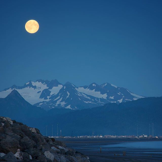Blue moon rising across Kachemak Bay as seen from Homer Spit, Alaska.