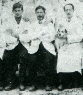 1912: Thomas Page, Henry Page and a man with a dog