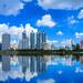 Cityscape image of Benchakitti Park at blue sky background in Bangkok, Thailand.