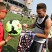 Kevin Alston signs an autograph at Revs Training