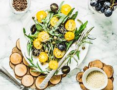 organic green salad with arugula, yellow tomatoes,…
